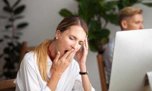 Image of girl yawning at work